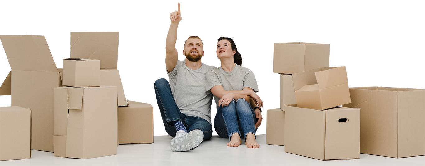 Couple sitting with boxes next to them