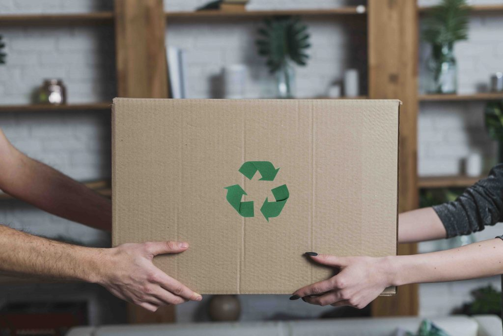 Moving box hand exchange with recycle icon